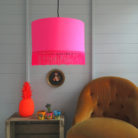 tropical neon pink lampshade with fringing