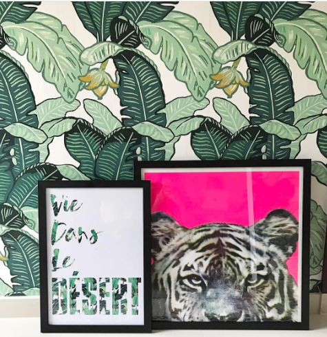 The standout Feuilles De Luxe Banana Leaf Wallpaper from Loft And Us and this punchy Tiger Print from Nelly Duff.