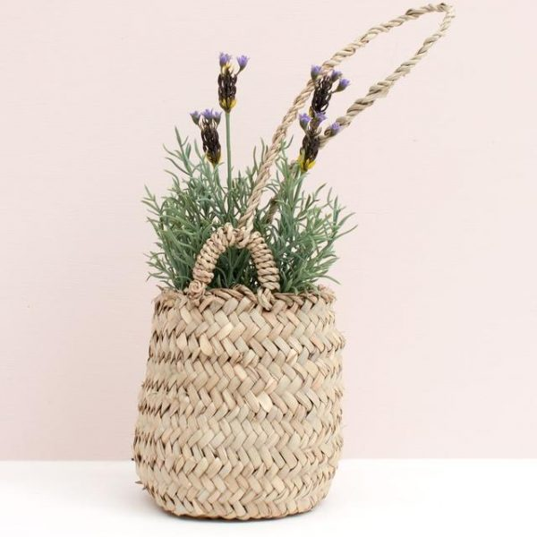 Handmade woven palm leaves hanging basket