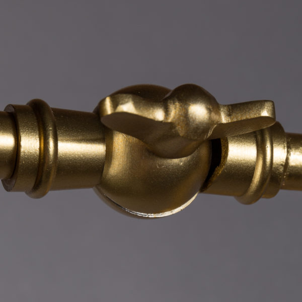 Close up of butterfly bolt for black and brass lamp