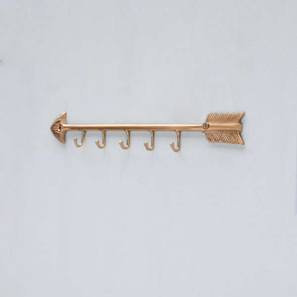 Brass Arrow Display Rack in Matt Gold