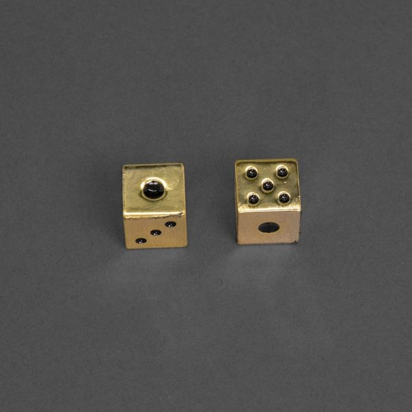 Luxe Gold Dice Set on grey background