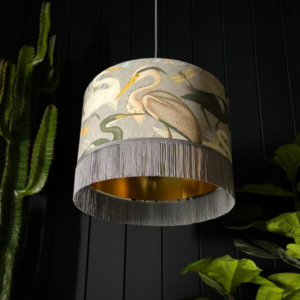 The Tranquil Bird Song Heron Lampshade With Fringing And Gold Lining